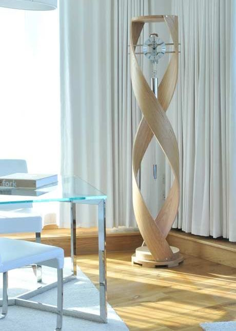 an ultra modern grandfather's clock of glass, metal and light colored wood