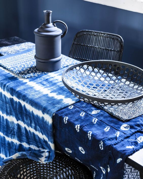 shibori tablecloths make this moody dining space cooler