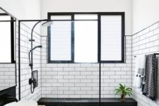 30 white subway tiles with black grout and matte black tiles with white grout make up an eye-catchy space
