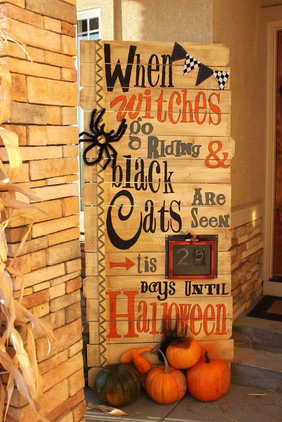 a gorgeous pallet sign with ribbons a black and white banner a faux spider