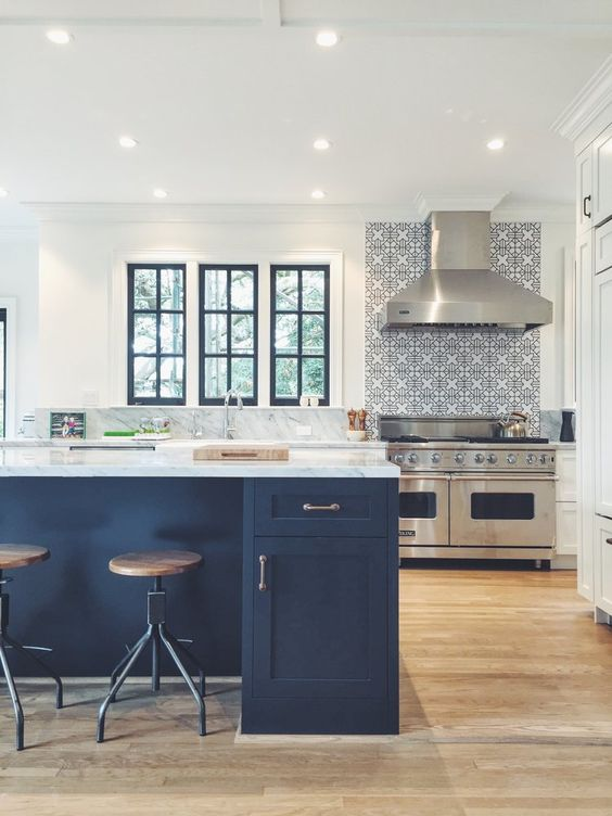 a neutral kitchen is made more chic with a navy kitchen island and window frames