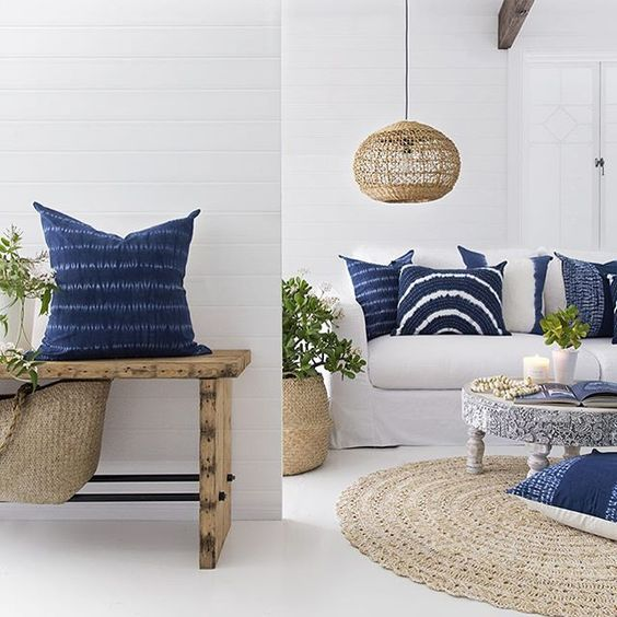 white seaside spaces are made chic with shibori pillows and wicker accents
