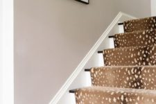 32 deer spot print rug covers the stairs and makes the space cozier