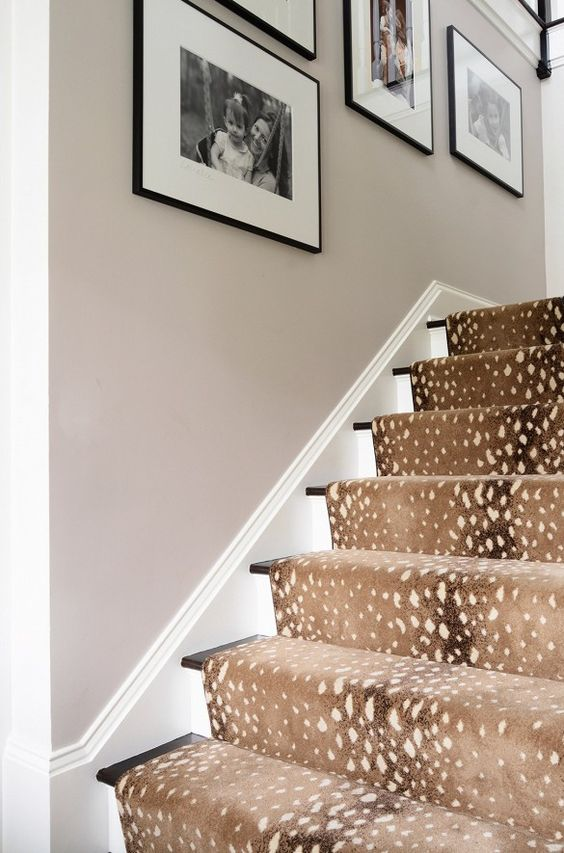 deer spot print rug covers the stairs and makes the space cozier