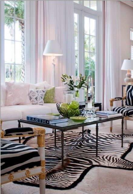exquisite zebra upholstery chairs and a zebra print rug for a glam space