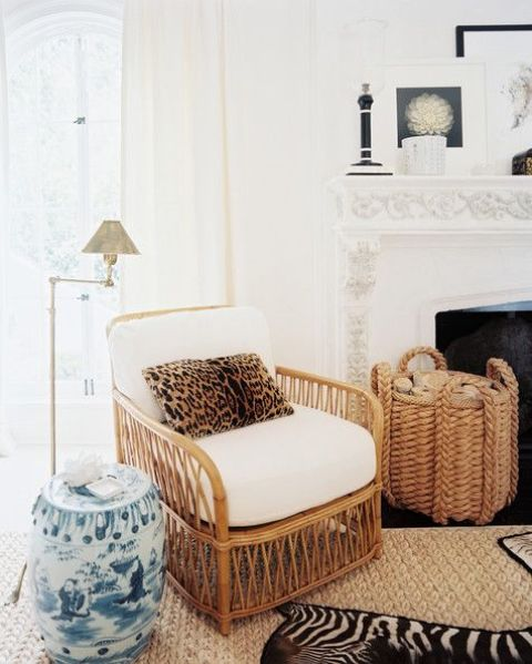 a cozy rustic living room with wicker furniture and a cheetah print pillow for an eye-catchy accent