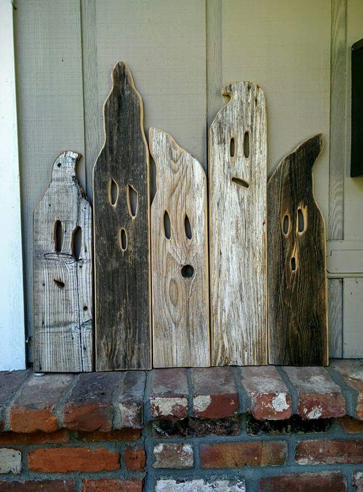 this is how you could turn a bunch of old wooden boards into an awesome front porch ghost decoration