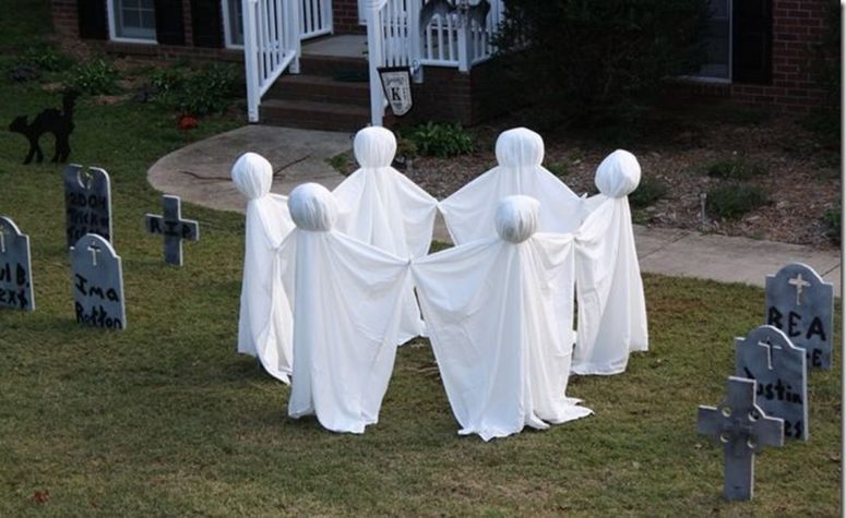 a bunch of graves and ghosts dancing around them would turn your front yard into a creepy place