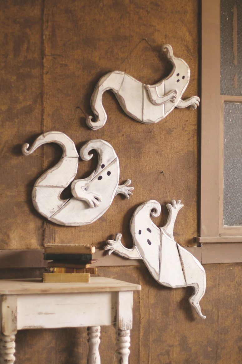 make wooden ghosts and hang them on a wall during this awesome season