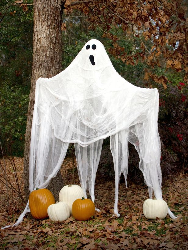 hang a life-size ghosts on a tree or place on your front porch