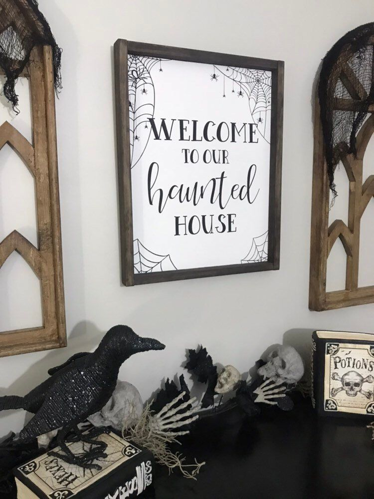 welcome to a haunted house sign could be used as a wreath as a wall art piece