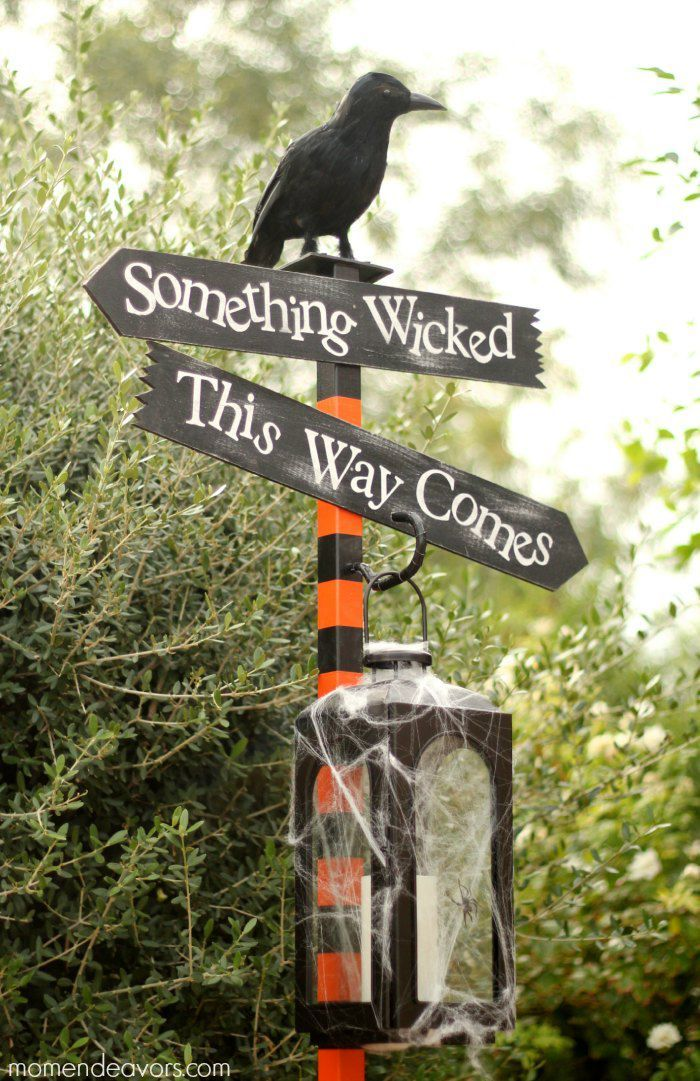 decorate any post in your backyard with a cool Halloween arrangment with several signs