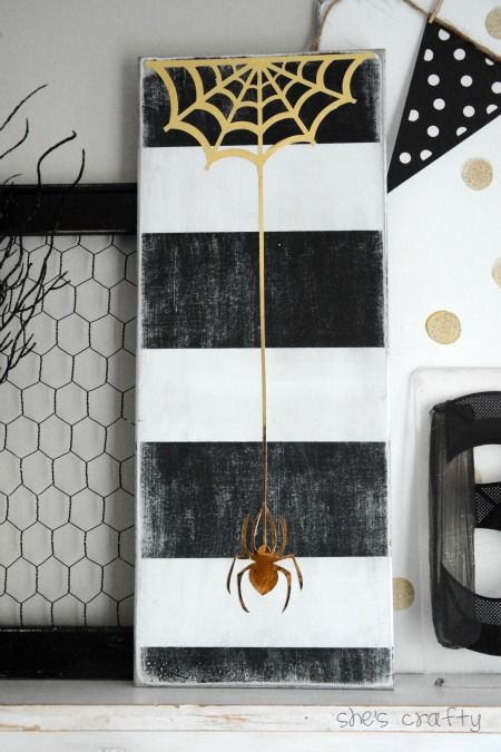 a reclaimed board and some shiny paper could be used to make a cool diy halloween sign