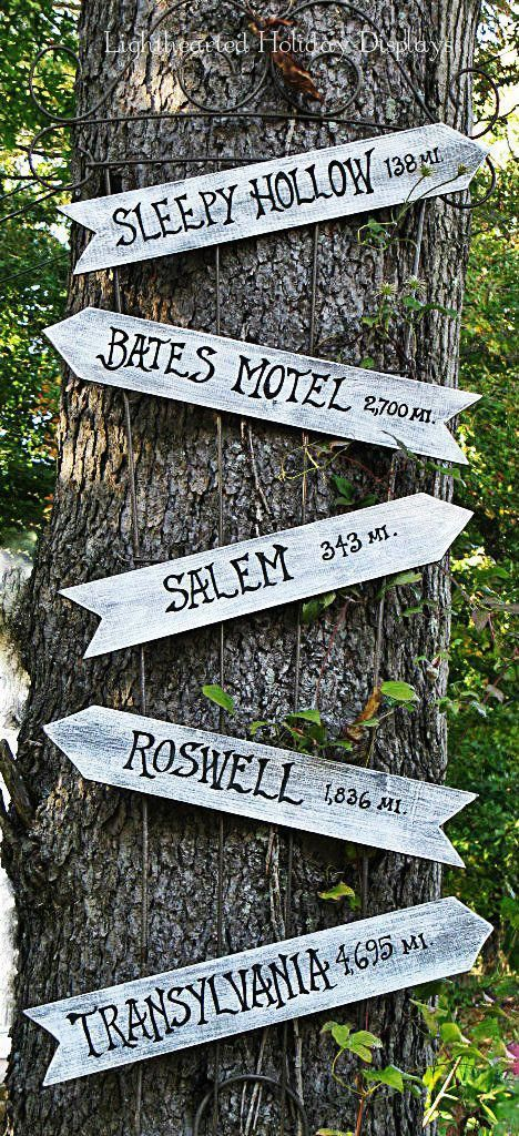 point out to spooky attractions with a sign hung up on a tree