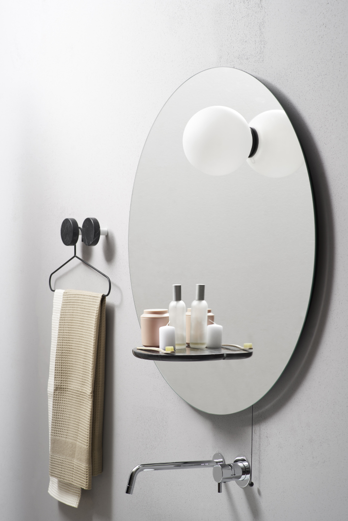 Float is a functional modern mirror inspired by planets and gravity and featuring additional light and storage