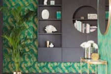 01 The entryway of this quirky penthouse is done with bold emerald anad gold wallpaper and lots of gilded details
