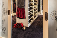 01 This dreamy closet is an amazing space done with white wardrobes and shelves with additional lights and comfy brown carpet all over the floor