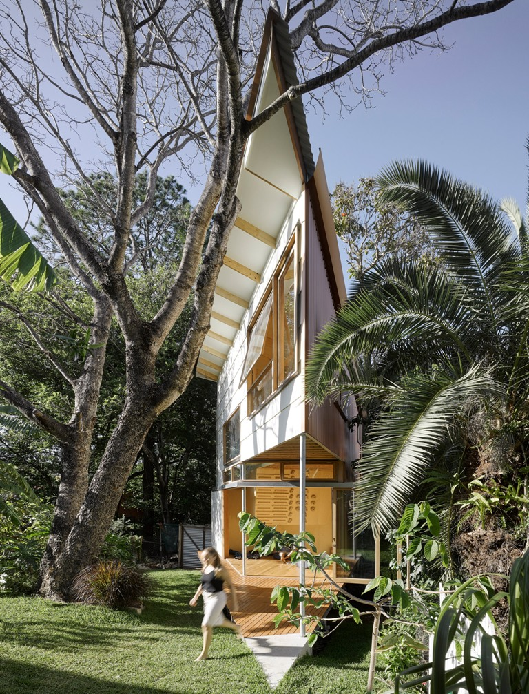 This garden house was built in treehouse style and it features a pointed design with several spaces inside