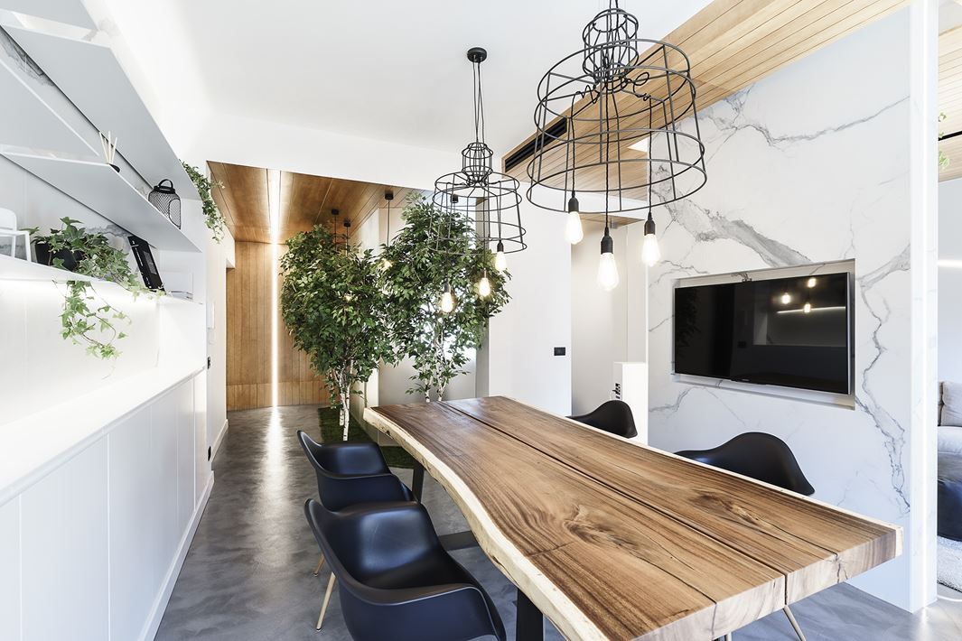 This gorgeous modern apartment is a living space and a design studio in one, it's defined by modern touches and lots of greenery and trees