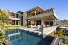 01 This gorgeous modern residence is built using concrete, wood and local stone and privacy is kept