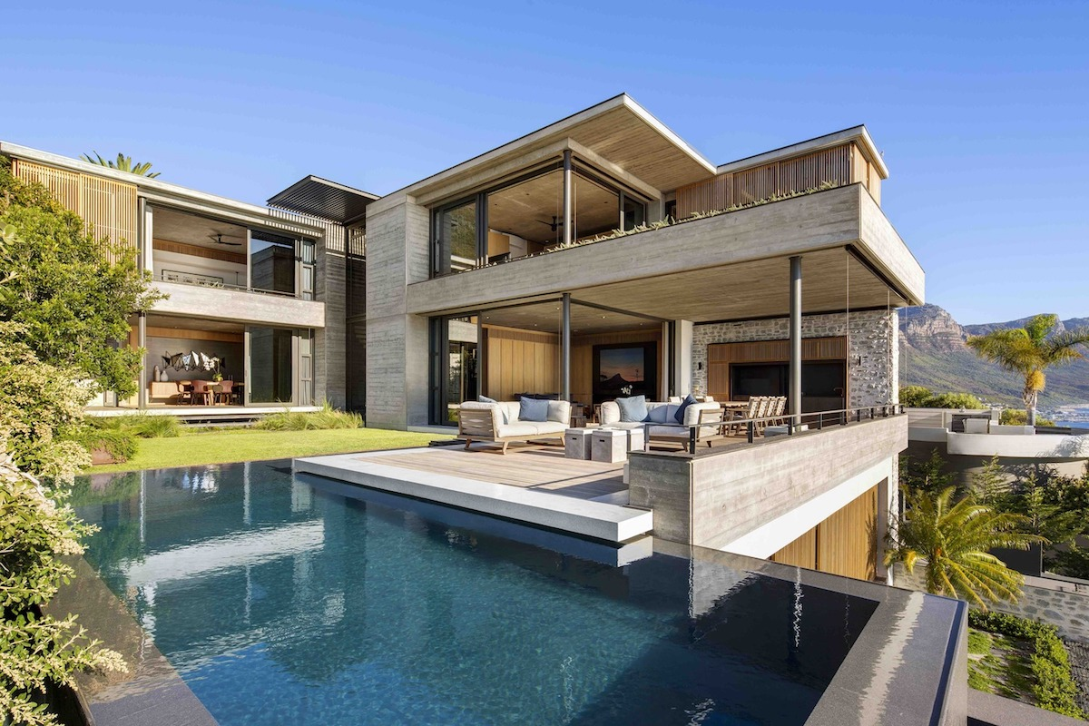 This gorgeous modern residence is built using concrete, wood and local stone and privacy is kept