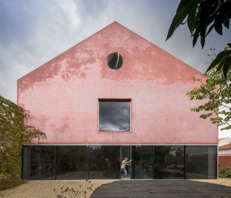 An Old Winery Turned Into A House Covered With Red Mortar