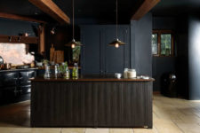 01 This stunning dark space was created by deVOL for one cottage, and its vintage moody decor really stands out