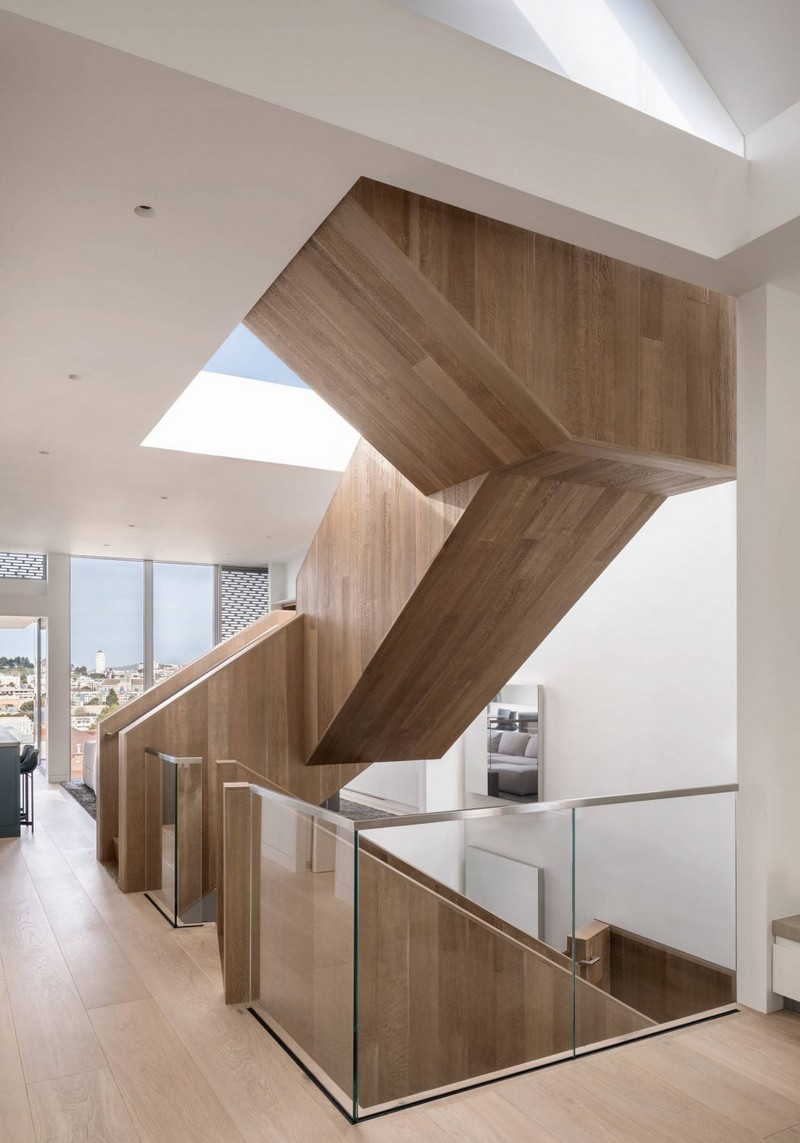 A sculptural staircase made of wood goes through all the floors and makes a statement