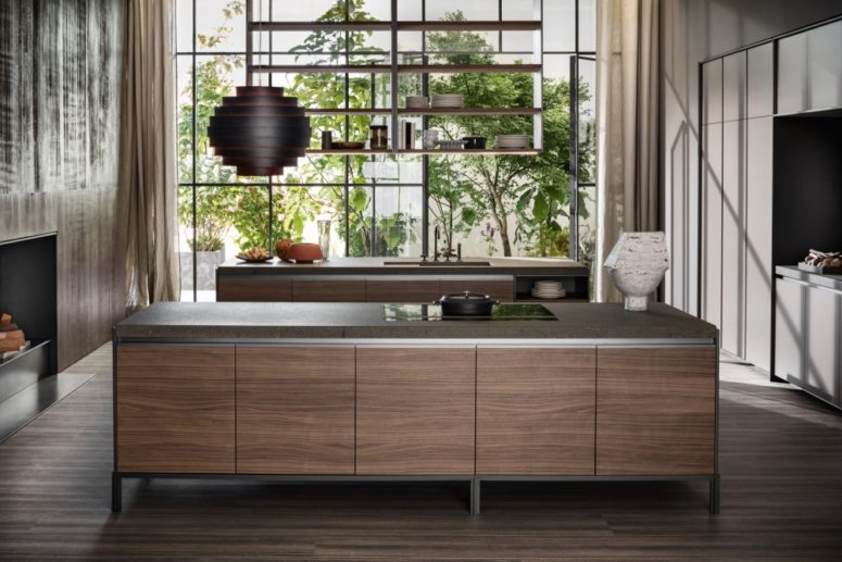 The countertops are durable and solid, the wooden cabinets add a necessary play of materials and a chic look