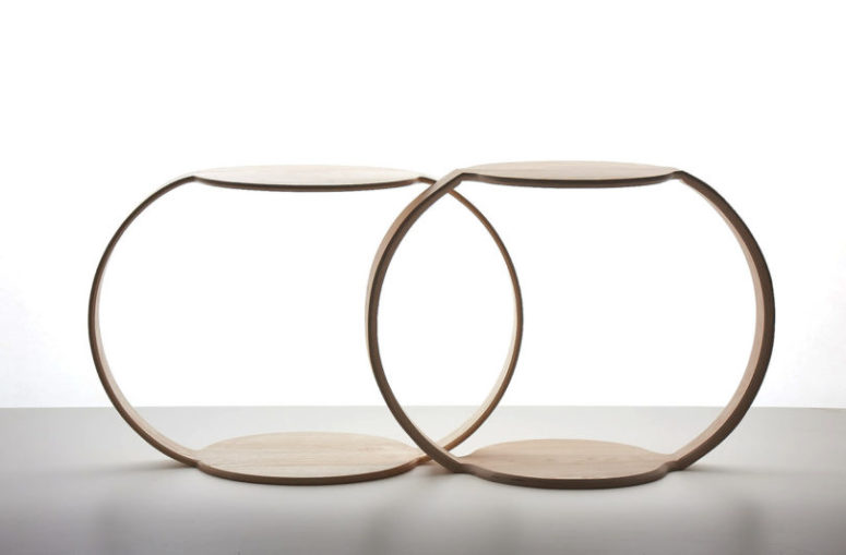 The item is made of molded ash veneers, and the round tabletop matches the opposite, which is the foot of the table