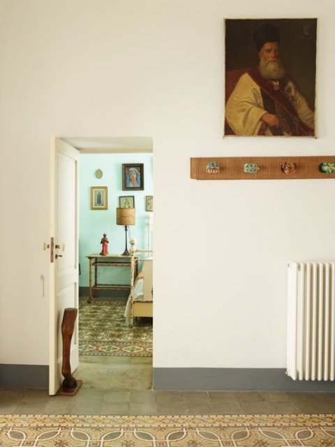 The owners loved the original tile floor, and added quirky touches and funny pieces
