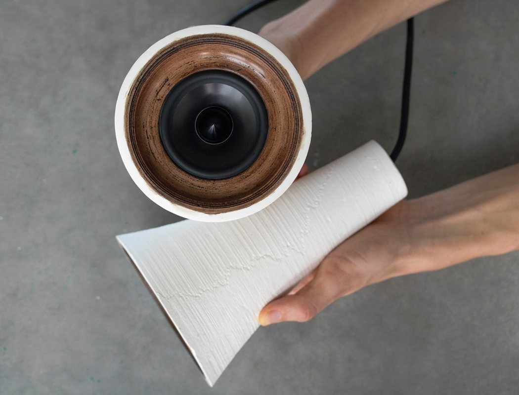 The speakers are made of wood PLA and a resin mix and look as if they are really ceramic ones