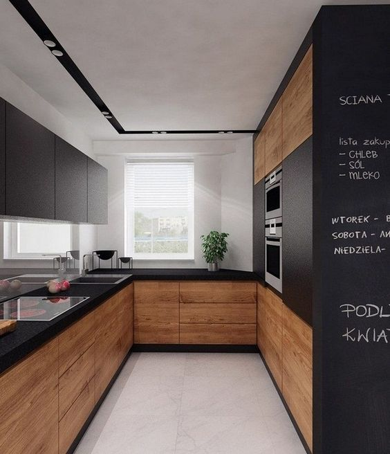 a matte black kitchen with natural wood surfaces looks modern, edgy and is very functional