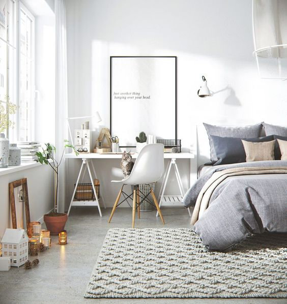 a modern Scandinavian bedroom with a workspace next to the bed, a sawhorse desk is a practical option