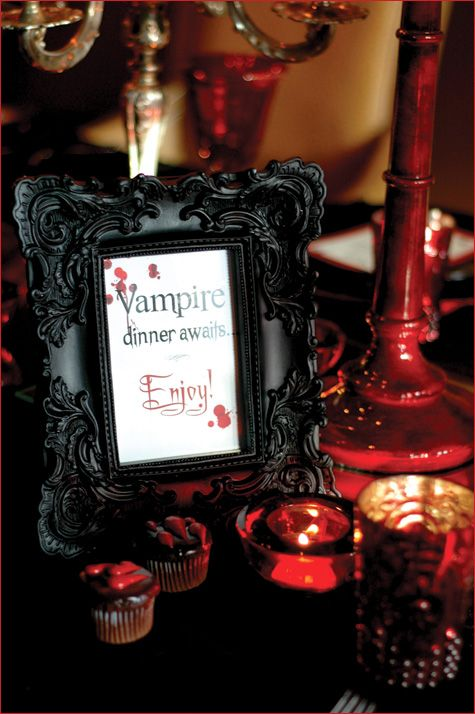 a stylish black framed sign, dark red and black decorations around