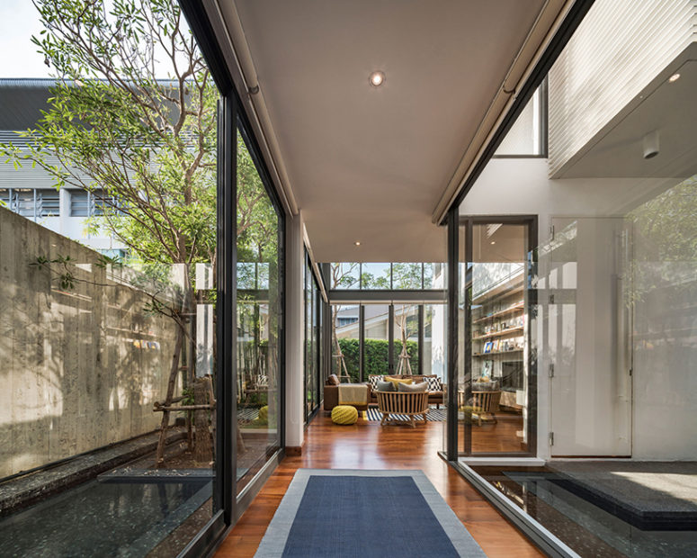 The enclosed spaces that provide privacy are created, while connecting the house to the urban ecology, and the inner courtyard brings much peacefulness inside