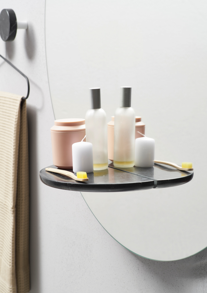 The shelf allows not to have a vanity as all small accessories can be placed here