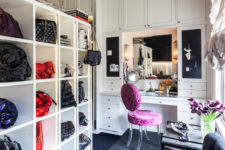 03 There's a shelving unit for bags, a cute makeup nook with several mirrors and chalkboard drawers and ruffled curtains