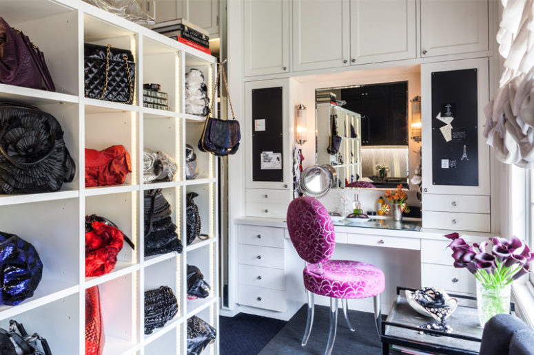 There's a shelving unit for bags, a cute makeup nook with several mirrors and chalkboard drawers and ruffled curtains