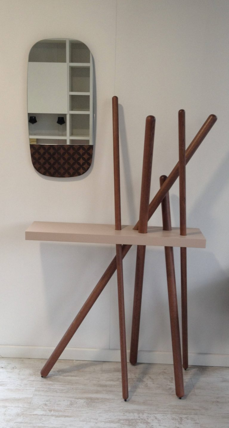 This is a coat hanger and a console and can be used throughout home for the same purposes, not only in entryways