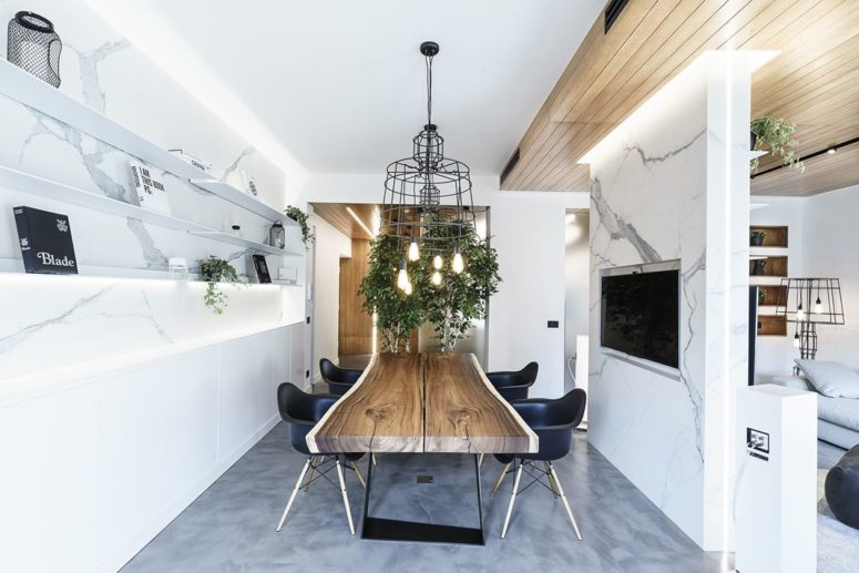 This space is used as a dining room and a conference space and is versatile enough for both