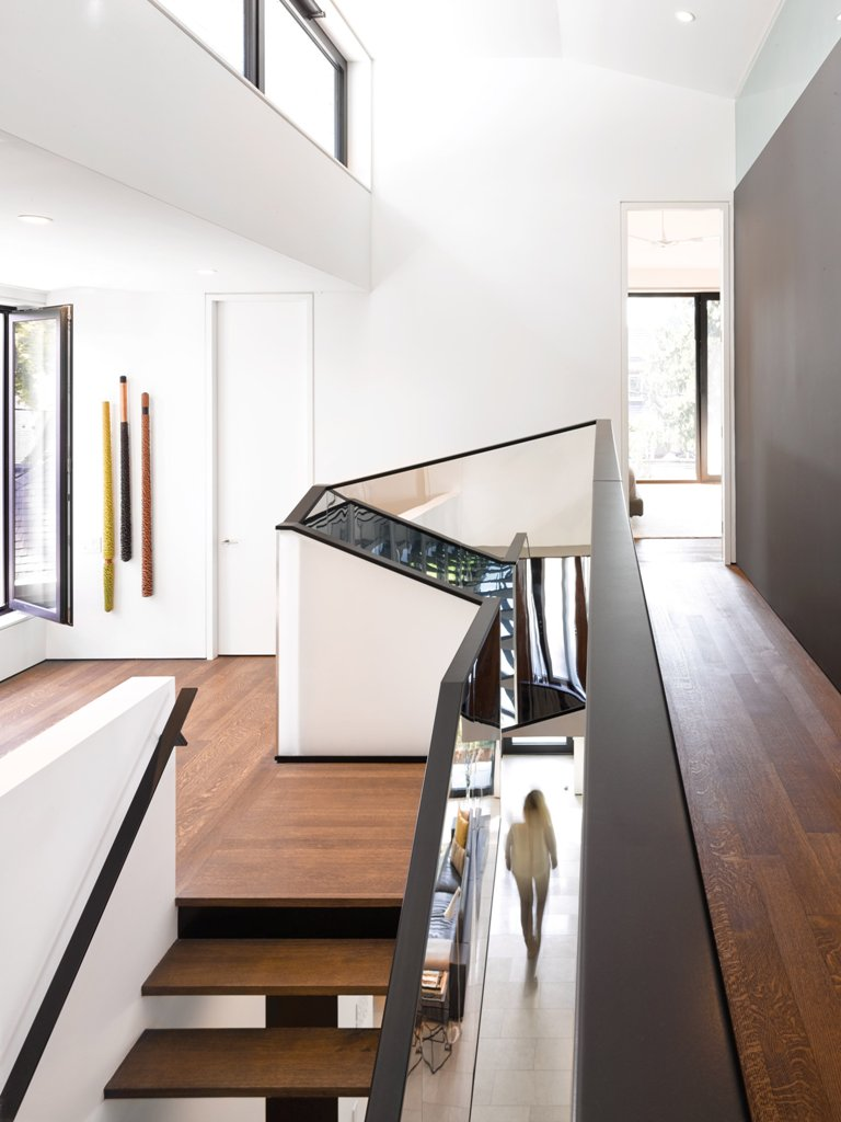 White walls bring an airy loft feeling and mirrors reflects the light making the home even airier