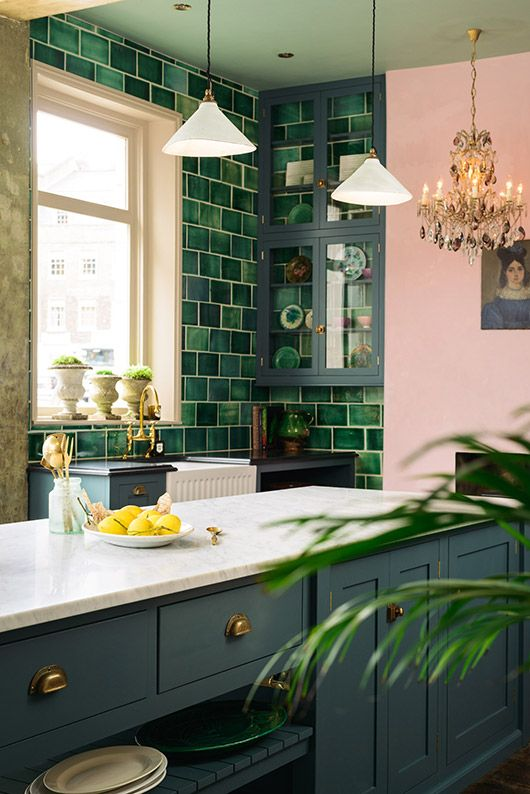 a green tile wall looks nice with grey cabinets and adds a cool bright touch to the kitchen