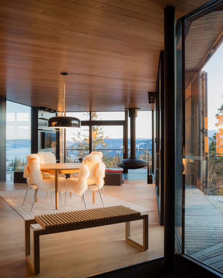 The inside is covered with oiled oak, and there's an open layout with adorable views