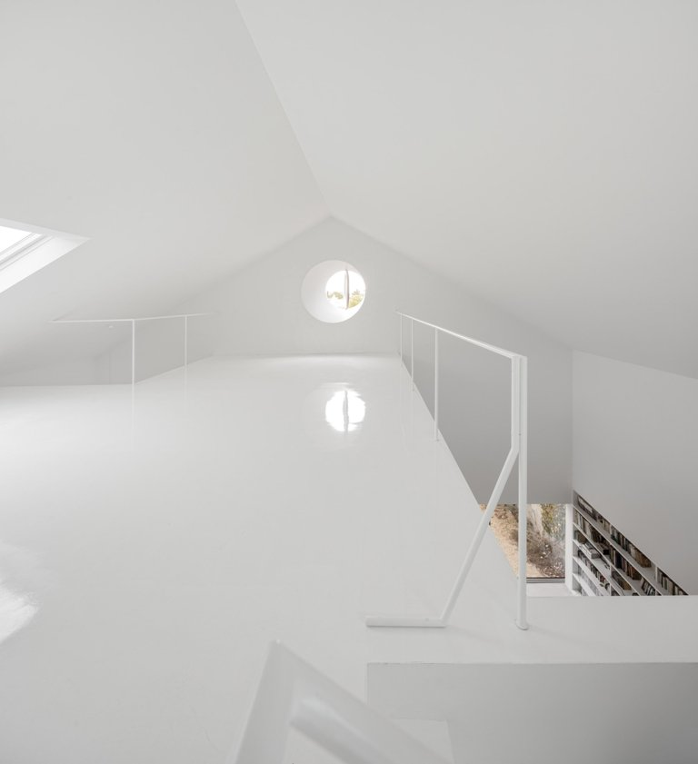 The upper level is a clean space with a pivoting window, and the owners can do anything here