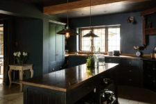 04 There's a large kitchen island with storage, some vintage accessories like scales and industrial pendant lamps