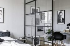 04 a masculine bedroom and a workspace separated with a glazed framed wall