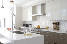 04 a modern space with sleek white cabinets and wooden ones, a geo tile backsplash and a marble kitchen island