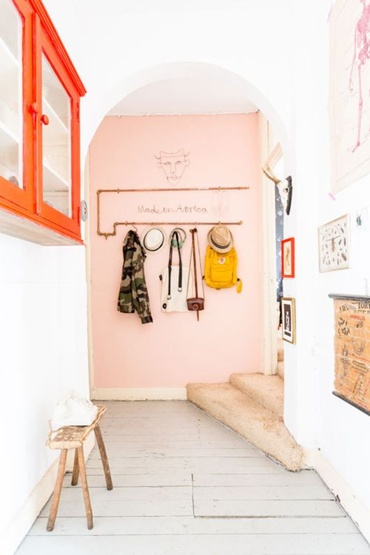a pop of pink here creates a soft and sweet look in this entryway