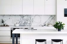 05 a white kitchen with a white marble backsplash and metal details for a cool look